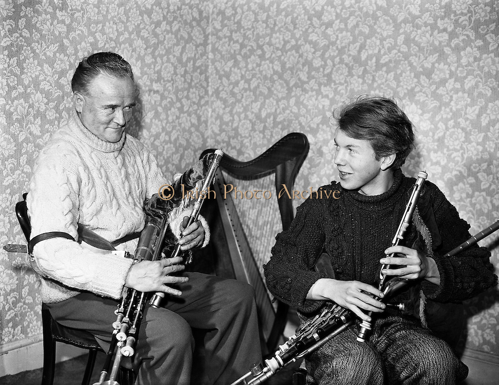 Garech Browne and Leo Rowsome.29/02/1959..Leo Rowsome (05/04/1903 - 20/09/1970) was the third generation of an unbroken line of uilleann pipers. He was performer, manufacturer and teacher of the uilleann pipes - the complete master of his instrument. He devoted his entire life to the uilleann pipes..Leo was born in Harold's Cross, Dublin in 1903. His father, William realised that his son had the ability to become a talented musician and craftsman. Constantly watching his father making and repairing instruments, Leo learned the art of pipe making and instrument repair. So rapid was his progress at piping that in 1919 at the age of sixteen he was appointed teacher of the uilleann pipes at Dublin's Municipal School of Music (now D.I.T. Conservatory of Music & Drama) for 50 years. He also taught at Dublin's Pipers Club of which he was President..His last commercial recording, CC1 ?Ri na bPiobairi? (King of the Pipers) was made for Claddagh Records in 1966..Leo Rowsome died suddenly whilst adjudicating 'The Fiddler of Dooney Competition' in Riverstown, Co. Sligo on 20 September 1970...The Hon. Garech Domnagh Browne, born 25 June, 1939, is a member of the titled family of Oranmore and Browne in the West of Ireland and is a wealthy patron of Irish arts, notably traditional Irish music. He is often known by the gaelic designation of his name, Garech de Brún, or alternately Garech a Brún especially in Ireland..He has been a leading proponent for the revival and preservation of traditional Irish music, through his record label Claddagh Records which he founded with others in 1959. His former house, Woodtown Manor, near Dublin was for many years a welcoming place for Irish poets, writers and musicians and which was associated with the folk-pop group Clannad, where they made many recordings of their music. When in Ireland, he lives at Luggala set deep in the Wicklow Mountains. The house has been variously described as a castle or hunting lodge of large proportio