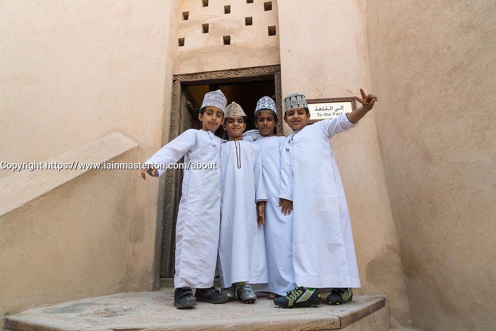 Omani schooboys  visiting Nizwa Fort in Oman