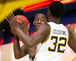 Feb 13, 2021; Berkeley, California, USA; Colorado Buffaloes guard McKinley Wright IV (25) looks for an open teammate around California Golden Bears guard Jalen Celestine (32) during the second half of an NCAA basketball game at Haas Pavilion. Mandatory Credit: D. Ross Cameron-USA TODAY Sports