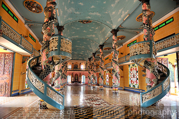 Ornate columns and spiral staircases inside the Cao Dai temple in Tay Ninh. Cao Dai (full name Dai Dao Tam Ky Pho Do), is the third largest religion in Vietnam, and this is its main temple, the Tay Ninh Holy See, in Tay Ninh, Vietnam