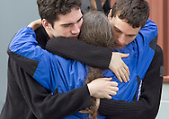 Augusta, New Jersey - A runner hugs family members near the finish line during the 3 Days at the Fair races at Sussex County Fairgrounds on May 13, 2012.