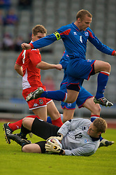 REYKJAVIK, ICELAND - Wednesday, May 28, 2008: Iceland's goalkeepr Fjalar Thorgeirsson saves at the feet of his own defender Kristjan Orn Sigurdsson during the international friendly match against Wales at the Laugardalsvollur Stadium. (Photo by David Rawcliffe/Propaganda)