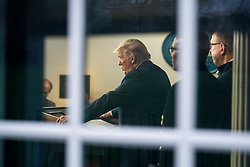 March 22, 2020, Washington, District of Columbia, USA: US President DONALD J. TRUMP surrounded by members of the White House Coronavirus Task Force, delivers remarks on the pandemic in the press briefing room of the White House. Efforts to contain the coronavirus COVID-19 pandemic have caused travel disruptions, sporting event cancellations, runs on cleaning supplies and food and other inconveniences  (Credit Image: © Jim Loscalzo/CNP via ZUMA Wire)