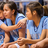 022814       Cable Hoover<br /> <br /> Window Rock Scout Kaitlyn Haven (20) comforts her teammate Sheniya Betsoi (33) as the bench reacts to the final moments of their match against the Valley Christian Trojans Friday at the Jobing.com Arena in Phoenix.