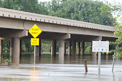 """Road Ends"" Sign in water 400 feet from the flooded Trinity River, Great Trinity Forest, Dallas, Texas, USA"