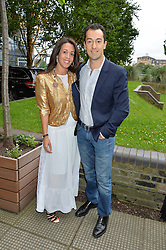 GEORGE & ZEINA EMBIRICOS at an Evening at The River Cafe in aid of the NSPCC held at The River Cafe, Thames Wharf, Rainville Road, London on 19th June 2016