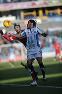 Sean Scannell of Huddersfield Town battles with Scott Malone of Cardiff City during the Sky Bet Championship match at the John Smiths Stadium, Huddersfield<br /> Picture by Graham Crowther/Focus Images Ltd +44 7763 140036<br /> 21/02/2015