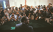 Photobraphers photograph Clarence Thomas at his confirmation hearings to be a justice on the Supreme Court in September 1991..Photograph by Dennis Brack bb24