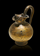Phrygian bronze trefoil spouted jug from Gordion . Phrygian Collection, 8th century BC - Museum of Anatolian Civilisations Ankara. Turkey. Against a black background .<br /> <br /> If you prefer you can also buy from our ALAMY PHOTO LIBRARY  Collection visit : https://www.alamy.com/portfolio/paul-williams-funkystock/phrygian-antiquities.html  - Type into the LOWER SEARCH WITHIN GALLERY box to refine search by adding background colour, place, museum etc<br /> <br /> Visit our CLASSICAL WORLD PHOTO COLLECTIONS for more photos to download or buy as wall art prints https://funkystock.photoshelter.com/gallery-collection/Classical-Era-Historic-Sites-Archaeological-Sites-Pictures-Images/C0000g4bSGiDL9rw