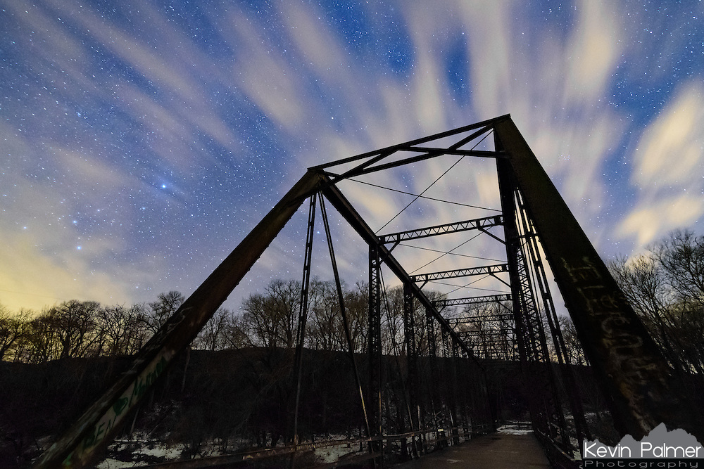 Quick moving clouds pass above an old abandoned bridge in Tazewell County, Illinois, on a winter night.