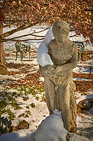 Birdbath and statue covered with snow. Backyard Autumn Nature in  New Jersey. Composite of six images taken with a Leica T camera and 18-56 mm lens (ISO 100, 56 mm, f/14, 1/60 sec)