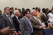 North Charleston Keith Summey (right) and Police Chief Eddie Driggers (right) take part in a healing service at Charity Missionary Baptist Church April 12, 2015 in North Charleston, South Carolina. Rev. Al Sharpton later spoke following the recent fatal shooting of unarmed motorist Walter Scott police and thanked the Mayor and Police Chief for doing the right thing in charging the officer with murder.