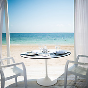 A table is set up for a romantic dinner on the beach at Playa Mujeres on Mexico's Caribbean coast. The Beloved Hotel, Playa Mujeres, Mexico, is located just north of Cancun. It's a luxury all-inclusive beach resort owned by the Excellence Group.