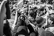 08272017 - Berkeley, California, USA: A protester is reflected onto their camera display by sunlight as they yell at a protester from the opposite side of the political spectrum in Martin Luther King Park during the Bay Area Against Hate rally. A huge crowd gathered in the park where several Trump supporters, and others associated with alt-right causes clashed sporadically with hundreds of Antifa and counter protesters, sometimes violently. Police arrested over a dozen.