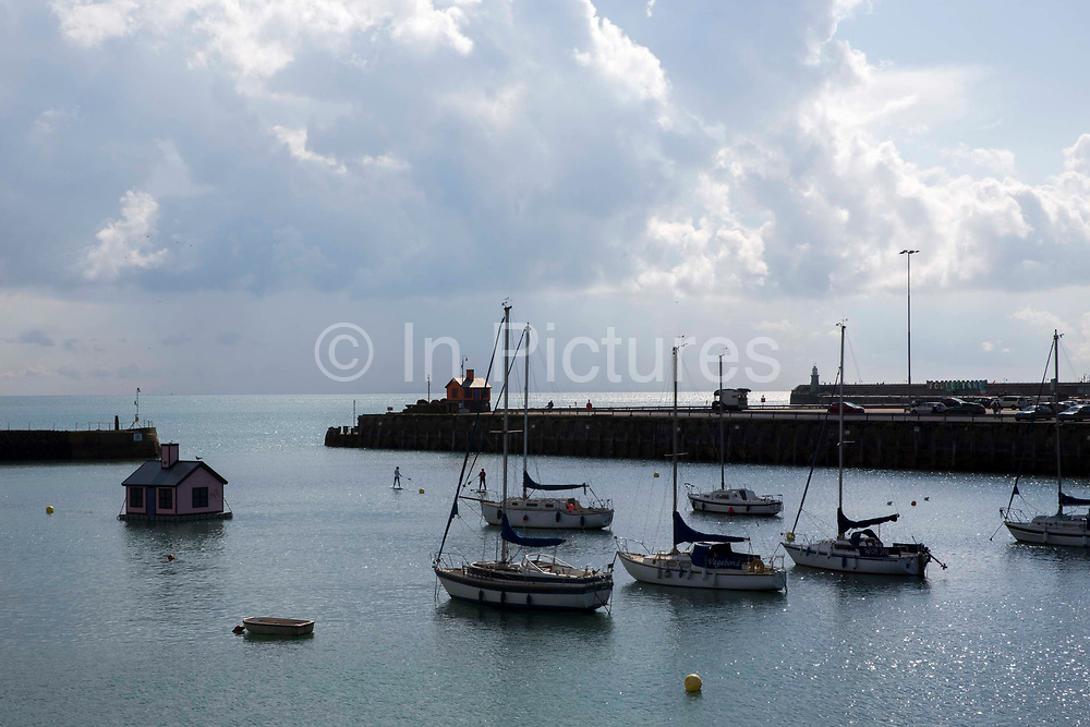 Folkestone Harbour Holiday homes. Two bungalows in Folkestone Harbour built by the artist Richard Woods as part of the 2017 Folkestone Triennial. Folkestone, Kent. The artist wanted to create a piece about second homes and the housing crisis in the UK.