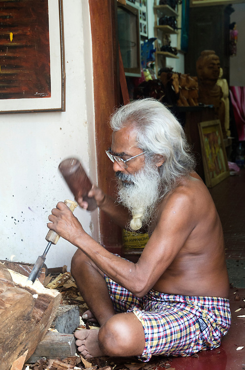 Craftsman working with wood in Galle Fort, Sri Lanka