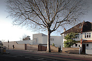 Modern House in Denmark Hill, London with bare tree in foreground.