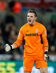 Jack Butland of Stoke City celebrates after Bojan Krkic scores a goal from the penalty spot to make it 0-1 - Mandatory byline: Rogan Thomson/JMP - 07966 386802 - 19/10/2015 - FOOTBALL - Liberty Stadium - Swansea, Wales - Swansea City v Stoke City - Barclays Premier League.