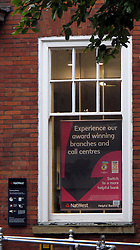 "Licensed to London News Pictures 22/06/2012.."" Experience our award winning branches and call centres "" says the poster in the window of the NatWest banks' , Sale, Cheshire branch. Something many NatWest customers wished they didn't need to as the banks' computer problems continue, causing misery for many customers...Photo Credit Julian Brown/LNP.."