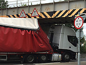 Lorry collides with railway bridge