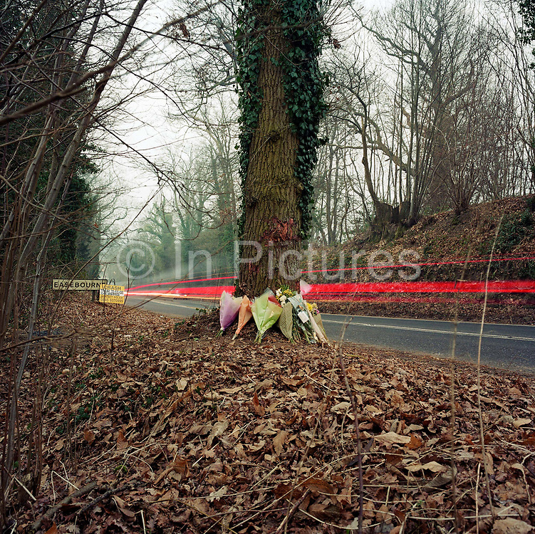 """This memorial has been placed where young men called Steve, Si and Sammy died on the A286 Easebourne, Sussex, England, UK. If we drove past this place where someone's life ended, the victim would just be an anonymous statistic but flowers are left to die too and touching poems and dedications are written by family and loved-ones. One reads: """"""""I am the lucky one - my son survived - I wish so much it had been all of them."""" From a project about makeshift shrines: """"Britons have long installed memorials in the landscape: Statues and monuments to war heroes, Princesses and the socially privileged. But nowadays we lay wreaths to those who die suddenly - ordinary folk killed as pedestrians, as drivers or by alcohol, all celebrated on our roadsides and in cities with simple, haunting roadside remberences."""""""