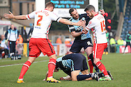 a scuffle breaks out as Paul Hayes of Wycombe Wanderers pushes Michael Tonge of Stevenage after Luke Wilkinson of Stevenage kicks Luke O'Nien of Wycombe Wanderers in an attempt to get the ball. Skybet football league two match, Wycombe Wanderers  v Stevenage Town at Adams Park  in High Wycombe, Buckinghamshire on Saturday 12th March 2016.<br /> pic by John Patrick Fletcher, Andrew Orchard sports photography.