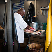 Cleaning fish at the Maine Avenue Fish Market in Washington DC. The fish cleaning shop will clean, gut, and filet to your requests.