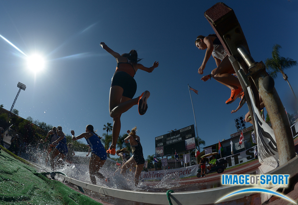 Apr 18, 2013; Walnut, CA, USA; Runners race over the water jump in the womens steeplechase in the 55th Mt. San Antonio College Relays at Hilmer Lodge Stadium.