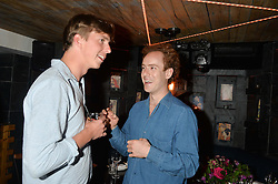 Left to right, ALEC MILLS and TOM INSKIP at the launch of Geisha at Ramusake hosted by Piers Adam and Marc Burton at Ramusake, 92B Old Brompton Road, London on 11th June 2015.