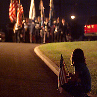 (PMONMOUTH) middletown 10/2/2001  Heather Miller 9 of Middletown sits on the curb as the color guard leads a procession to a vigil mass for WTC attack victims at Normandy Park in Middletown.  Michael J. Treola Staff Photographer....MJT