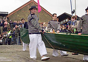 """Putney. London.  2004 University Boat Race,  Championships Course, Putney to Mortlake. <br /> Re enactment row Boat Race. , Cambridge and Oxford . OUBC Boating from the  Andrew LiINDSAY. """"Hard"""" to complete [Mandatory Credit Peter SPURRIER]"""