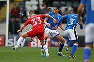 Jim McNulty challenges Mark Byrne during the EFL Sky Bet League 1 match between Rochdale and Gillingham at Spotland, Rochdale, England on 23 September 2017. Photo by Daniel Youngs.