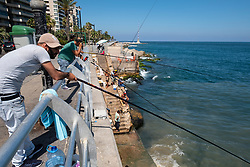 Men fishing from the Corniche in Beirut, Lebanon.