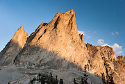 The peak of El Capitan (9901 feet or 3018 m elevation) in Sawtooth Wilderness, Blaine County, Idaho, USA. The Sawtooth Range (part of the Rocky Mountains) are made of pink granite of the 50 million year old Sawtooth batholith. Sawtooth Wilderness, managed by the US Forest Service within Sawtooth National Recreation Area, has some of the best air quality in the lower 48 states (says the US EPA).