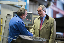 © Licensed to London News Pictures . 23/03/2015 . Middleton , UK . Nigel Farage meets sheet metal workers at the factory . UKIP leader Nigel Farage , Deputy Leader Paul Nuttall and Economics Spokesman Patrick O'Flynn announce UKIP's economic policy at Concept Metal Products and Co Ltd in Middleton , Lancashire . Photo credit : Joel Goodman/LNP