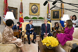 US President Donald J. Trump (C-R) welcomes Korean President Moon Jae-in (C-L) to the Oval Office of the White House while Mrs. Kim Jung-sook (L) and US First Lady Melania Trump (R) look on in Washington, DC, USA, 11 April 2019. President Moon is expected to ask President Trump to reduce sanctions on North Korea in an attempt to jump start nuclear negotiations between North Korea and the US.