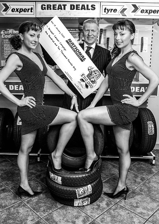Breast Cancer Campaign. Cheeky girls presenting cheque. with National tyres  CE Alan Revie and Pamela Goldberg. 19/1/05<br /> photo-jacky chapman