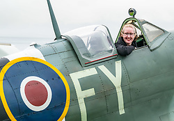 Pictured: Scotland's National Airshow, East Fortune, East Lothian, Scotland, United Kingdom, 27 July 2019 . A packed programme of aircraft old and new planned to take to the skies for the aerial display was marred by poor weather at airfields around the country which meant that many of the promised flights were unable to perform. People are able to sit in a spitfire plane.<br /> Sally Anderson | EdinburghElitemedia.co.uk