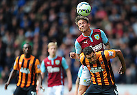 Burnley's Matthew Taylor vies for possession with Hull City's Jake Livermore<br /> <br /> Photographer: Chris Vaughan/CameraSport<br /> <br /> Football - Barclays Premiership - Hull City v Burnley - Saturday 9th May 2015 - Kingston Communications Stadium - Hull<br /> <br /> © CameraSport - 43 Linden Ave. Countesthorpe. Leicester. England. LE8 5PG - Tel: +44 (0) 116 277 4147 - admin@camerasport.com - www.camerasport.com