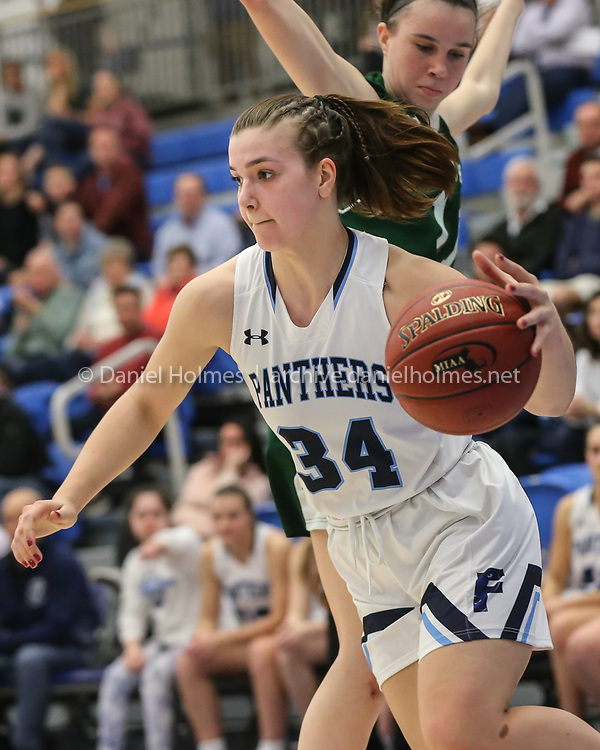 Franklin's Megan O'Connell slides passed the defense during the Division 1 state semifinals against Minnechaug at Worcester State University on Mar. 10, 2020. The Panthers beat the Falcons, 55-43. [Daily News and Wicked Local Photo/Dan Holmes]