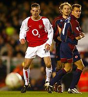 Photo: Scott Heavey.<br /> Arsenal v Middlesbrough. FA Cup Fourth Round. 24/01/2004.<br /> David Bentley gets the better of Gaizka Mendieta and Szilard Nemeth