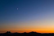 Moon at dusk over the mountain peaks of the High Sierra, Leavitt Pass, Emigrant Wilderness, California
