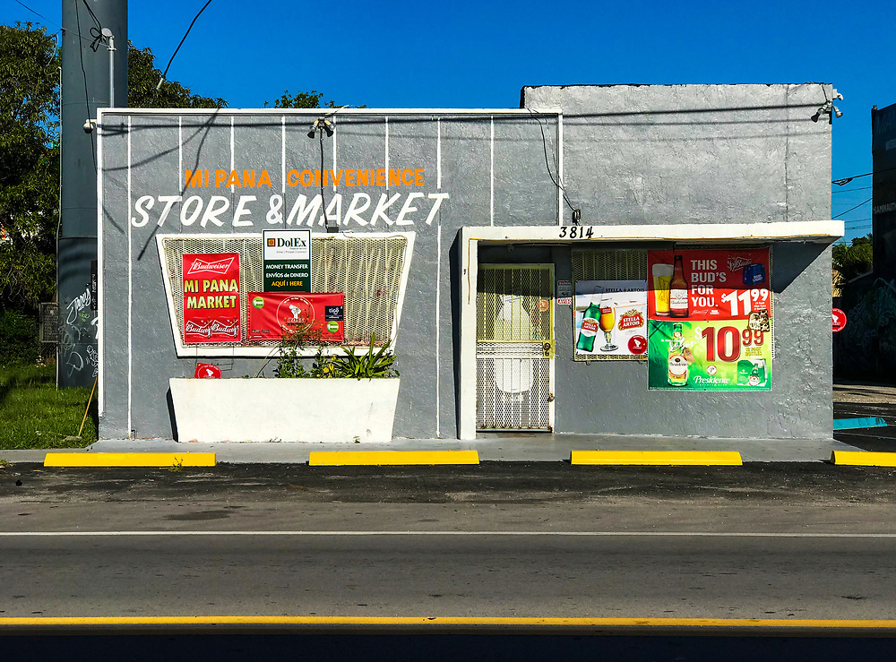 A convenience store in a small Miami Modern style commercial building in Miami's Buena Vista West neighborhood