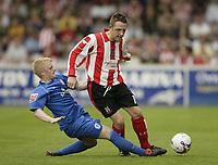 Photo: Aidan Ellis.<br /> Lincoln City v Rochdale. Coca Cola League 2. 06/05/2006.<br /> rochdale's John doolan tackles Lincoln's Scott Kerr