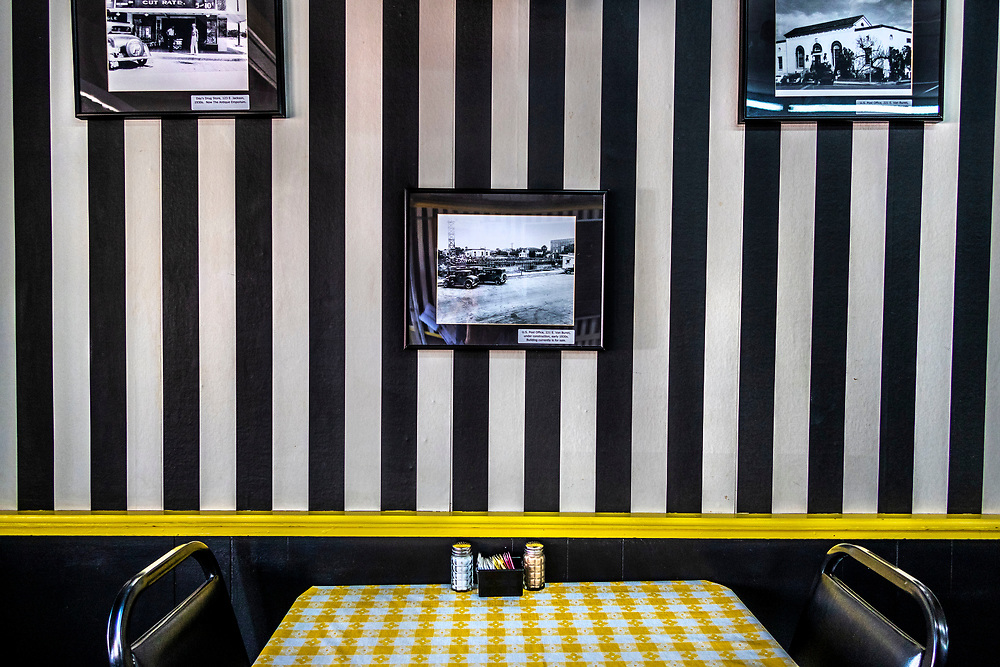 J & B's Cafe. Black and white striped wall paper, with old photos, cafe, Harlingen, Texas, USA