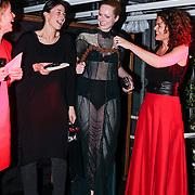 NLD/Amsterdam/20121129- Uitreiking Red's Hot Women Awards 2012, Winnares in de categorie Mode Conny Groenewegen (niet op de foto) prijs wordt in ontvangst genomen door Jolanda van den Berg  in een door Conny Groenewegen ontworpen jurk
