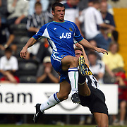 Notts County's Nick Fenton clears from Wigan Athletic's Lee McCulloch
