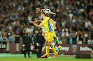 Andy Carroll of West Ham United heads the ball over Gaber Dobrovoljc of NK Domzale. UEFA Europa league, 3rd qualifying round match, 2nd leg, West Ham Utd v NK Domzale at the London Stadium, Queen Elizabeth Olympic Park in London on Thursday 4th August 2016.<br /> pic by John Patrick Fletcher, Andrew Orchard sports photography.