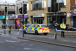 **CAPTION CORRECT: Shooting took place on December 4th**<br /> © Licensed to London News Pictures. 05/12/2019. London, UK. The scene on Wood Green High Road near Turnpike Lane underground station after shooting at 11.13 pm on Wednesday 4 DECEMBER 2019. A 17 years old boy is fighting for his life in hospital after suffering gunshot wounds on Wood Green High Road, north London. Photo credit: Dinendra Haria/LNP