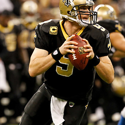 December 4, 2011; New Orleans, LA, USA; New Orleans Saints quarterback Drew Brees (9) against the Detroit Lions during a game at the Mercedes-Benz Superdome. The Saints defeated the Lions 31-17. Mandatory Credit: Derick E. Hingle-US PRESSWIRE